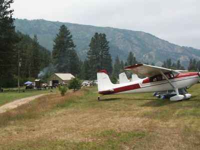 Grass Landing Strip with planes parked on side